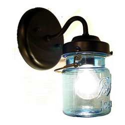 Vintage Blue Mason Jar Sconce Light, Antique Black - A handcrafted sconce lamp that lights a blue, original vintage canning jar with all its own history and 'age' marks. Featuring both the original wire-bale and raised lettering.