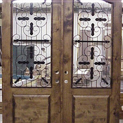 Old World Collection - DbyD3429 - The beautiful glass work and iron grill in this set of double doors is striking. It's a great way to add interest to your entryway.