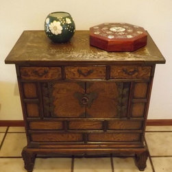 Vintage Chinese Chest w/butterfly hardware - This is a vintage Chinese trunk or chest with 3 drawers along the top and an open cupboard below. The hinges and center hardware are brass butterflies, there is paneling on the front with exotic wood grain, curved feet with crossbar supports. Drawer pulls are flat brass, there is also brass detail on the corners.