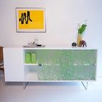 Spot on Square - Alto Credenza | Spot on Square - Made in Europe by Spot On Square.At home  anywhere in the house, the Alto Credenza's innovative translucent panels give this piece a playful charm. Two translucent sliding panels open to reveal a storage area that can be used for baby essentials, clothes, or dishes. Hidden cable management cut outs allows this cabinet to function effectively for media components as well. Additional storage is located in the open shelving located on the end of the credenza for displaying keepsakes or keeping often used items close at hand. When used it the nursery, the Alto Credenza allows for hidden attachment of the optional Changing Tray so it can also function as a changing table. Product Features:  Hidden cable management cut outs 100% recycled, reclaimed, green grade MDF Translucent panels with organic materials Two open shelves on the end, and two shelves concealed behind sliding panels Eco-friendly, water based, non-toxic paint Produced in a FSC certified factory Compatible with optional Alto Changing Tray Decorative panels are free from BPAs, phthalates, dioxins, lead, cadmium, and endocrine disrupters Ships assembled