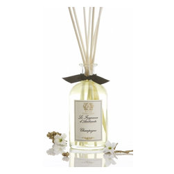 "Antica Farmacista - Prosecco Scent Room Diffuser - Petite Size for a Petite Space"" Our Antica's new collection of 100ml Home Ambiance Fragrances are approved for carry-on baggage, making this reed diffuser a great gift for an out of town guest or a fragrant reminder of home to bring along wherever life takes you. The perfect size for your personal space and the perfect price for your wallet. Champagne - Inspired by the unique spirit and style of truly exceptional champagne, this holiday fragrance is vibrant, fresh and ravishing. Sparkly top notes of satsuma citrus balance beautifully with subtle floral notes of muguet. Sensuous apricot, nectarine and passion fruit complement the sweetness of sugared black currant. Mellow accents of sweet vanilla ground this incredibly fresh, effervescent scent. * 100 ml * Complete with birch reeds and gift tag * Made In Italy"