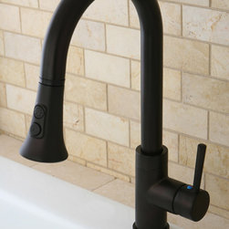 None - Kitchen Single Handle Oil Rubbed Bronze Faucet with Pull-Down Spout - This stately, single-handle, oil-rubbed faucet offers a simplistic design that will not overwhelm your kitchen. The oil-rubbed bronze faucet is highlighted by a gooseneck-shaped spout, making your kitchen appear organized and contemporary.