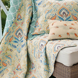 Tangiers Quilt - Evoking the exotic beauty of a souk find, our Tangiers quilt looks like a piece you might have picked up on one of your faraway travels. Deliciously soft and gauzy in lightweight cotton, it's patterned with stylized flowers and flowing scrolls in sunset shades.