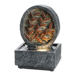 ORE International - 9.5 in. Tabletop Fountain w Metal Leaves Acce - Includes multi-tone river pebbles. Water cascades behind metal leaves. Halogen light for an illuminating effect. 30 Days warranty. Made from metal and polyresin. Gray color with textured finish. Antique Copper finish. 6 in. L x 4.25 in. W x 9.5 in. H (5 lbs.)To add peace and tranquility to your home. Well, this is the perfect item. It would go perfect on a side table as an added touch or as a centerpiece. It will surely provide a relaxing and soothing atmosphere. Inspired by garden floral, this gorgeous copper leaf table fountain combines the charm of the outdoors with soft illumination and flowing water. Polished river pebbles are included. That is sure to create an inner harmony.