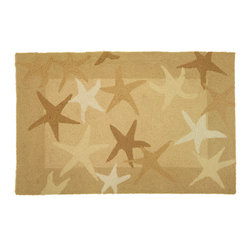 Homefires - Starfish Field Rug - Immortalize your love of the beach with this wool look-alike accent rug. The starfish sunbathing on the sand bring the feeling of a day at the beach to your living areas. Bucket and shovel not included.