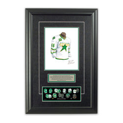 """Heritage Sports Art - Original art of the NHL 2007-08 Dallas Stars jersey - This beautifully framed piece features an original piece of watercolor artwork glass-framed in an attractive two inch wide black resin frame with a double mat. The outer dimensions of the framed piece are approximately 17"""" wide x 24.5"""" high, although the exact size will vary according to the size of the original piece of art. At the core of the framed piece is the actual piece of original artwork as painted by the artist on textured 100% rag, water-marked watercolor paper. In many cases the original artwork has handwritten notes in pencil from the artist. Simply put, this is beautiful, one-of-a-kind artwork. The outer mat is a rich textured black acid-free mat with a decorative inset white v-groove, while the inner mat is a complimentary colored acid-free mat reflecting one of the team's primary colors. The image of this framed piece shows the mat color that we use (Hunter Green). Beneath the artwork is a silver plate with black text describing the original artwork. The text for this piece will read: This original, one-of-a-kind watercolor painting of the 2007-08 Dallas Stars white jersey is the original artwork that was used in the creation of this Dallas Stars uniform evolution print and tens of thousands of other Dallas Stars products that have been sold across North America. This original piece of art was painted by artist Nola McConnan for Maple Leaf Productions Ltd. Beneath the silver plate is a 3"""" x 9"""" reproduction of a well known, best-selling print that celebrates the history of the team. The print beautifully illustrates the chronological evolution of the team's uniform and shows you how the original art was used in the creation of this print. If you look closely, you will see that the print features the actual artwork being offered for sale. The piece is framed with an extremely high quality framing glass. We have used this glass style for many years with excellent results. We pac"""