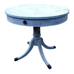 Used Antique Round Wood Pedestal Table - This antique solid wood round pedestal table is painted in Miss Mustard Seed Milk Paint in the color Shutter Gray, which actually appears to be grayish blue. The random chips and distress of this table lends it charming character. The frame is comprised of a single pedestal with four legs that are capped in dark metal which complements the dark metal hardware.