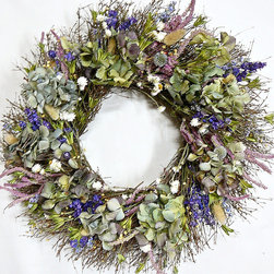 "Frontgate - Multicolored Northwest Garden Wreath - 22"" - Made with all natural materials. Designed for indoor use or protected outdoor display. Extend the life of floral materials by keeping it away from direct sunlight and moisture. Display a breezy combination of blue, green and lavender dried flowers, all gathered with the the essence of Pacific northwest gardens in mind. An elegant statement for a kitchen, breakfast room, or a powder room, this cultured mix includes dried hydrangea, purple globe thistles, lavender statice, larkspur, bushy setaria, white ammobium, and yellow fennel flower, all on a quail brush twig base.. . ."