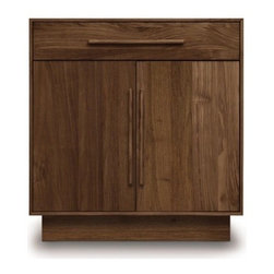 Copeland Furniture - Copeland Furniture | Moduluxe One-Drawer over Two-Door Dresser, 35-Inch High - Made in Vermont by Copeland Furniture.This trim bedroom cabinet offers open storage options for the modern bedroom. The 35-Inch Moduluxe One-Drawer over Two-Door Dresser features a multi-door/drawer combination that can easily house clothing, linens, bedding and other bedroom essentials. This precisely crafted wooden chest is part of the Moduluxe series of sectional furniture for the bedroom. This highly configurable bedroom and storage system can adapt to most spaces and needs. Use the One-Drawer over Two-Door Dresser Doors as a standalone piece. Or, it can be configured with other 35-Inch pieces in the collection for a modular bedroom solution.The Moduluxe One-Drawer over Two-Door Dresser Doors is crafted in solid cherry hardwood (available in six finishes), maple hardwood (available in eight finishes) or in natural walnut hardwood drawer pulls that match the drawer face. Doors include soft close (self closing) door hinges and interiors are open with adjustable shelving. All drawers feature asymmetrical English dovetail joinery. Drawer interiors are fully finished and sanded with bottoms jet-welded and side mounted, full extension soft-close drawer slides offer smooth operation. Select from two configurations (drawers at left or right). Then select from 15 wood finishes, and one of two satin surface finishes: standard Copeland Lacquer top coat or formaldehyde free Copeland Water Based top coat.Note: The back side of this Copeland case good is constructed in fully finished Baltic birch plywood panel which may not exactly match the rest of the case.
