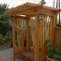 Rustic Western Style Furniture - Custom trellis seating with mesquite slab for seat.