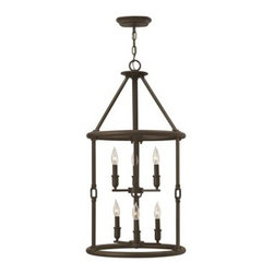 Hinkley Lighting - Hinkley Dakota Oil Rubbed Bronze Six-Light Mini-Chandelier - The Dakota collection rounds up the best in Western style with a rustic chic design. Cast metal faux leather straps and buckle combine with clear seedy hurricane shades perched on cast cups for luxe lodge charm.Under four generations of family leadership Hinkley Lighting has transformed from a small outdoor lantern company to a global brand intent on bringing you the best in style quality and value. LIFE AGLOW: That's their mantra and they take it seriously. By welcoming their products into your home they become part of your family's everyday life illuminating small moments and big occasions. They understand your home is so much more than a physical place. It's an emotional space designed by you so they are committed to keeping your 'Life Aglow' with stylish state-of-the-art lighting. Their products are the ultimate combination of style and substance. They are constantly developing new technologies to make their fixtures even more energy efficient. Hinkley recently upgraded their LED to cutting-edge high lumen output integrated solutions and they give you hundreds of energy-efficient styles to choose from. Even their Cleveland-based world headquarters employs high energy saving standards with low VOC materials and a variety of eco-smart applications into the design to make an earth-friendly work environment for their Hinkley family. Hand crafted fixtures luxe finishes artistic details and quality materials go into the design of every product they make. They embrace the philosophy that you can merge together the lighting furniture art and accessories you love into a beautiful environment that defines your own personal style.