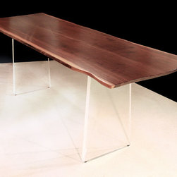 Walnut Acrylic Dining Table - A Walnut book-matched, live edge top supported by an Acrylic base comprise this minimal trestle table by Ray Bachand