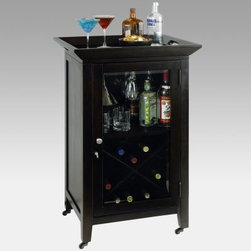 Howard Miller Butler Wine Rack Console - The Howard Miller Butler Wine Console may just be the perfect piece of furniture for smaller scale rooms. This mobile bar is made of select hardwoods and veneers wrapped in a Black Coffee finish with protective clear coat.Lift off the top tray and you have a handy way to serve beverages and hors d-oeuvres. Open the clear glass door to access the organized X-design wine cubby that holds up to 13 bottles and stores them correctly too. The upper shelf holds liquor bottles and glasses and even has stemware racks for wine and martini glasses. Not only does this wine butler have smooth rolling caster wheels it also lets you lock the door. And at 19.75D x 24W x 38.25H inches it works in almost any size room - perfect!The Howard Miller StoryIncomparable workmanship unsurpassed quality and a quest for perfection - these were the cornerstones of the company Howard C. Miller founded back in 1926 at the age of 21. Even then Howard Miller understood the need to create products that would be steeped in quality and value.In 1989 Howard Miller began creating collectors' cabinets with the same attention to detail and craftsmanship inherent in their clock-making. Fashioned from glass and hardwoods Howard Miller cabinets are ideal for displaying heirlooms plates glassware and other collectibles.A highly respected brand Howard Miller maintains its popularity because of the company's commitment to quality. Every product manufactured at the company's sprawling facility in Zeeland Michigan undergoes stringent tests and exceeds industry standards to ensure a lifetime of enjoyment.