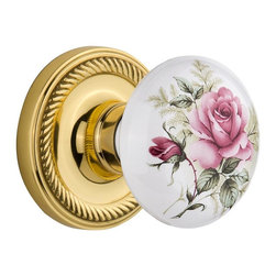 "Nostalgic - Nostalgic Mortise-Rope Rose-Rose Porcelain Knob-Polished Brass (NW-711310) - Blending rich detail and subdued refinement, the Rope Rosette in polished brass captures a style that has been a favorite for centuries. And, nothing says ""vintage"" like the traditional floral illustration of the White/Rose Porcelain Knob. All Nostalgic Warehouse knobs are mounted on a solid (not plated) forged brass base for durability and beauty."
