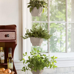 3-Pot Self-Watering Hanging Herb Planter - How about an herb garden that waters itself? I love the idea! I also love the fact that it's a hanging garden, which means there's no need to spare floor or counter space.