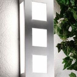 "CMD - CMD Aqua Trilio 26 outdoor wall sconce - Product description:  The Aqua Trilo 26 outdoor wall sconce is designed and produced by CMD. It is finished in stainless steel and features a satined glass. Quality made in Germany with a 10 years manufacturers warranty. Details:                         Manufacturer:             CMD                            Made in:            Germany                            Dimensions:             h: 16"" (40 cm) x w: 6.3"" (16cm) ext: 3.5"" (9 cm)                                            Light bulb:             2 x 60W; not included                            Material             steel, satined glass"