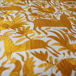 Hand-Embroidered Otomi Fabric, Yellow by Yucu Ninu - Real Otomi fabrics have become incredibly popular in recent years, and they have the ability to elevate a room to an entirely new level. The pattern, sheen and rich colors will ensure that it takes center stage in your space. If I wanted to add character to a vanilla room, I'd throw one of these over the back of the sofa, or use it as a bedspread.