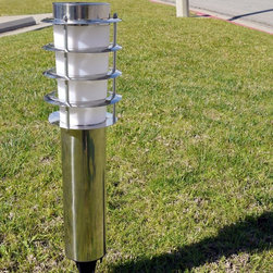 Homebrite - Homebrite Solar Torch Lights - Set of 2 - Stainless Steel Multicolor - 30154/2 - Shop for Lighting from Hayneedle.com! The modern Homebrite Solar Torch Lights - Set of 2 - Stainless Steel have a retro twinkle in their eyes. These cylindrical accent lights feature wide-angle dual LED lights for 360-degrees of ultra-bright illumination. They feature a solar panel in the top to harness the sun's power during the day and reflect it onto your home and lawn at night with up to eight hours of power when fully charged. LED bulbs included.About Homebrite:Founded in 1985 Homebrite restructured their manufacturing process in 2002 in order to focus on developing and improving solar lighting technology. Their innovations in this field led them to quickly become one of the leading specialists in LED lighting. Their dedication to only bringing proven-effective products to the market is reflected in their ten thousand hours of testing to ensure product quality and reliability. Homebrite's constant innovation led to the development of their Super Bright Technology delivering intense brightness with the energy-saving cost-effective use of solar technology. From solar path lights to solar stepping stones and rock spotlights Homebrite's products will provide safety and energy-efficiency to your favorite outdoor spaces.