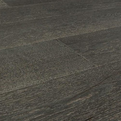"Vanier - Vanier Engineered Hardwood - Hampton Wide Plank Collection - [30.3 sq ft/box] - Cottage Gray / Oak / 7"" -The Hampton Beach series on the Vanier label offers rich colors and artfully patterned engineered wood flooring on generous wide-plank surfaces. Each option is designed to lend your space a laid back, cozy and comfortable space. Designed to thrive in a wide variety of installation contexts, your chosen option in a hardy and decorative engineered wood flooring board is the basis for high-end style, and long-term performance.    Real oak flooring surfaces    The unique grain patterns matched with rich colors are the jewel in the crown of each option in the Hamton Beach Series. Offered in a wide-plank, wire brushed format, every selection found here presents colors on the cooler end of the spectrum for subtle style, and understated grandeur in residences and in light commercial spaces too.     Installations in basements, in hallways and living areas, and in bedrooms are all viable options with a wood species that's been relied upon for centuries. And with modern floor board engineering to support it, you can benefit from a high level of ease, performance, and efficiency, too.    Each wood flooring surface is treated with an aluminum oxide finish to guard against abrasion. And with a DIY-friendly glueless locking system on each uniquely patterned board, you can create the space you're looking for more easily, faster, with less mess.       High-end engineered wood oak flooring for less    At BuildDirect, we want to support your vision to create the most stylish, long-lasting spaces you can. To do this, we've partnered with the experts in engineered wood oak flooring to get the best visual effects, with the most hard-wearing floor boards in the industry. That's what our manufacturing partners deliver as wood flooring industry experts; surfaces that are characterized by look, performance, and long-life.    And what we deliver is a channel to market that is more efficient, and will save yo"