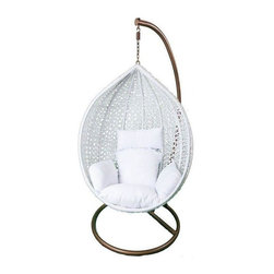 Used Hanging White Rattan Chair White Cushions - A white hand-woven weatherproof synthetic plastic rattan hanging chair with white cushions, so leisurely that it takes you back to the tropics! The rattan teardrop shaped form creates the space for a cozy nest of cushions and hangs from a strong rust resistant iron frame. It is a striking example of high design for your indoor or outdoor living space. Rattan is tailored for those who appreciate upscale furniture design with a tropical edge.