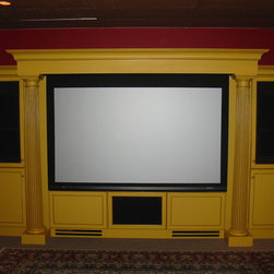 "Home Theaters - This beautiful, custom made media cabinet houses a built in 100"" Stewart Firehawk drop down motorized film screen."