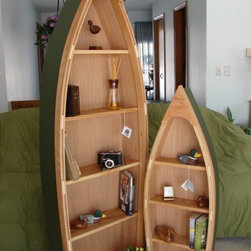 "Six-Foot Handcrafted Wood Row Boat Bookshelf By Poppa's Boats - For a nautical-themed kid's room, these boat bookshelves would be just the ticket. You could even ""name"" the boat with some paint to make it more personal."