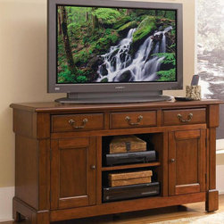 HomeStyles - TV Console in Rustic Cherry Finish - Three storage drawers. Open storage in center. Storage compartment with an adjustable shelf. Two storage cabinets with an adjustable shelf. Bold top molding. Marlborough style feet. Cable accessible. Perfect balance of warmth and style. Made from poplar solids and cherry veneers. 56 in. W x 20 in. D x 32 in. H. Assembly InstructionsCreate ambiance with a perfect balance of warmth and style with the Aspen Collection.
