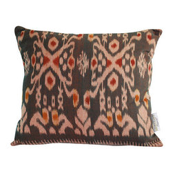 Brilliant Imports - Gray Ikat Pillow - We shopped for this ikat fabric outside of Ubud. After each vivid fabric was carefully chosen, I met with a seamstress who works across the street from my friend Suparta, in Ubud.  We analyzed the pattern to create the perfectly shaped pillow dimensions that highlight the beauty of the fabric design.  Each pillow was then handmade to these specifications. In gray cotton ikat with pink accents. Includes insert.