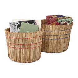 Traditional Straw Fibers Baskets - Set of 2 - Sweep away clutter with this creative basket set. Featuring a new take on the classic cleaning tool, each playful broom-inspired bin has sturdy, natural straw fiber walls bolstered by eye-catching blue and red threads. When not corralling your magazine collection, folded throws, or toys, the basket duo nests into a neat stack that can be easily tucked into storage.