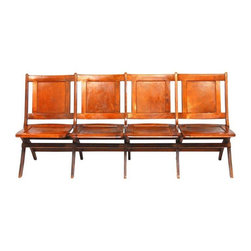 """Pre-owned Oak Folding Theater Chairs - A row of vintage oak folding theater chairs from Alameda Country School District in California. They have a rich, warm finish on the solid wood. The 1920s chairs are strong and stable, featuring quality construction. They fold completely flat, and have graceful, curving legs and back rests with an aged patina. Add some fun, function, and nostalgia to your hallway, dining table or even the foot of your bed.    Measurements: 73""""w x 22""""d x 33""""h  16""""h seat"""