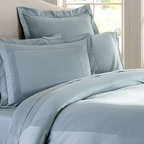 Hotel 600-Thread-Count Duvet Cover, King/Cal. King, Porcelain Blue - Like bedding found in the finest luxury hotels, our duvet cover and sham are sateen woven to a luxurious 600-thread-count, giving them supersoft texture and a silky luster. Made of 100% cotton sateen. 600-thread count. Duvet and sham reverse to self. Duvet cover has a hidden button closure and interior ties to keep the duvet in place; sham has an envelope closure. Duvet cover, sham and insert sold separately. Machine wash. Made in Italy. Monogramming is available at an additional charge. Monogram will be centered on the duvet cover and the sham.