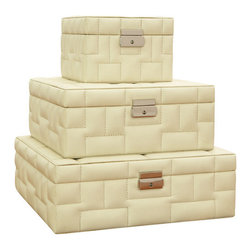 Set of Beige Leather Quilted Storage Boxes - As you unlock this beige leather quilted storage box and lift the lid, your heart swells with joy. Your great-grandmother's necklace sits carefully displayed within. You lift the chain, removing your treasure from safe keeping. She would be so proud of you. You've held on to a family heirloom, and you've added to it. By passing down this stunning treasure box with your keepsakes, you'll fill it with your own memories, and they'll remain safe and sound through generations. The stitching reminds you of her. Add a keepsake of your own to be remembered by.