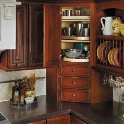 Getting Organized with Fieldstone Cabinetry - Corner cabinet with lazy susan.  Three drawers underneath for storage