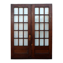"Antique Doors - A fabulous pair of salvaged French doors with beveled glass and a stained finish. The doors are divided fifteen-light doors, measuring 64"" wide, 83-1/8"" tall and 1-3/8"" thick. Item #NED90-RW, please check website for current availability."