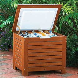 Improvements - Wood Ice Chest - The Wood Ice Chest has a lift-up hinged lid that stays open for easy beverage selection. This insulated cooler goes beautifully with your outdoor patio furniture. The Wood Ice Chest can be used outdoors or indoors. Our Wood Ice Chest is a real crowd pleaser. Our handsome wood beverage cooler allows your guests to choose their own drinks, keeping them happy and saving you time. The Wood Ice Chest is double-wall insulated on the inside (including the lid) to hold ice, cans and bottles. A drain plug at the bottom of this raised ice chest provides easy emptying of melted ice. Crafted of slatted eucalyptus, the Wood Ice Chest has a natural oil finish to coordinate with our tropical hardwood outdoor furniture. Benefits of the Wood Ice Chest: