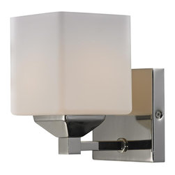 One Light Matte Opal Glass Chrome/matte Opal Bathroom Sconce - Rectangular shaped hardware and a complimenting cube shade create a straight contemporary look. This wall sconce is finished in chrome, and includes a matte opal shade. This fixture will add a touch of contemporary to any decor.