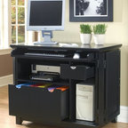 HomeStyles - Compact Desk in Black Finish - Includes file drawer that accommodates letter or legal size files. Cabinet has ample storage. Retractable keyboard tray. Small drawer with small adjustable shelf and doors fit flush against the unit when open. Keyboard with ball bearing drawer guides that fully extend. Printer shelf and CPU compartment. Eco-friendly and sustainable. Small drawer with adjustable shelf. Shelf accommodates printer. Made from Asian hardwood solids and engineered wood. Made in Thailand. Keyboard Drawer: 32 in. W x 15 in. D x 1.75 in. H. File Drawer: 21.25 in. W x 18.50 in. D x 10 in. H. Shelf: 23.25 in. W x 20.75 in. D x 8.25 in. H. CPU Compartment: 9.75 in. W x 21 in. D x 18.50 in. H. Small Storage Drawer: 7.75 in. W x 14.50 in. D x 2.25 in. H. Overall: 37.75 in. W x 23.75 in. D x 32.25 in. H. Assembly InstructionsThe arts and crafts compact office cabinet is a practical blend of artistry and utility. Arts and crafts styling will make it a welcome addition to any room. The cabinet is a logical addition to the home that needs an office work area but doesn't have the space.