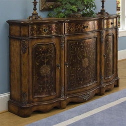 Pulaski - Accents 66 in. Credenza - Handpainted. Three drawers. Three doors. Adjustable shelf behind each door. Three door panels with finely drawn filigree centered by medallion shapes. Formal symmetry in scrolling cabinet shapes. Heirloom crete finish. 66 in. W x 16 in. D x 40 in. H (215.5 lbs.)Start creating your perfect room by first choosing a style shaper, such as this credenza with shape and ornamentation from the 18th century. Our heirloom crete finish emulates the patina of fine antiques. Accent furniture by Pulaski provides the finishing touch for any room in your home. Wonderfully reflect your unique sense of style.