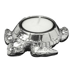 Arthur Court - Sea Turtle Tea Light - Striking the perfect balance of stateliness and whimsy, this sweet little sea turtle candle holder will provide space for one tea light on your side table or bathroom counter. Crafted from gleaming aluminum, this sculptural candle holder will be your new oceanic friend.