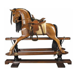 "Rocking Horse, Western Saddle - The victorian rocking horse measures 56"" x 18.3"" x 47.5"". Younger sons born into nobility or the gentry were often sent to serve at the Royal Court as pages of honor. Part of their education was learning tournament jousting. The master-at-arms used wooden horses mounted on swings to teach skills with sword and lance. This wooden horse evolved over time into the classic rocking horse. No upper class children's playroom was without one. Some were mounted on oval wood rockers, others on a 'safety' stand, where steel swings allowed for greater movement on a stationary base. Our iconic rocking horse is a full-sized reproduction of originals dating back to the 19th C. Hand carved in top quality mahogany. Hand made western saddle and tack of real bridle leather. The expert skills of wood carvers, cabinetmakers, and saddlers are evident. Hand finished in a warm and glowing French-style varnish, slightly distressed to make it look somewhat aged. A timeless treasure and a dream-toy for both boys and girls. Imagine its value in 50 or 100 years!"