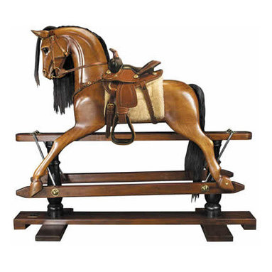 """Rocking Horse, Western Saddle - The victorian rocking horse measures 56"""" x 18.3"""" x 47.5"""". Younger sons born into nobility or the gentry were often sent to serve at the Royal Court as pages of honor. Part of their education was learning tournament jousting. The master-at-arms used wooden horses mounted on swings to teach skills with sword and lance. This wooden horse evolved over time into the classic rocking horse. No upper class children's playroom was without one. Some were mounted on oval wood rockers, others on a 'safety' stand, where steel swings allowed for greater movement on a stationary base. Our iconic rocking horse is a full-sized reproduction of originals dating back to the 19th C. Hand carved in top quality mahogany. Hand made western saddle and tack of real bridle leather. The expert skills of wood carvers, cabinetmakers, and saddlers are evident. Hand finished in a warm and glowing French-style varnish, slightly distressed to make it look somewhat aged. A timeless treasure and a dream-toy for both boys and girls. Imagine its value in 50 or 100 years!"""