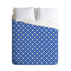 Caroline Okun Blueberry Twin Duvet Cover - Find your thrill. The blueberry, navy and white print on this duvet cover adds juicy color and fun pattern sure to wake up your bed. Made with soft woven polyester, it reverses to pure white dreaminess underneath.