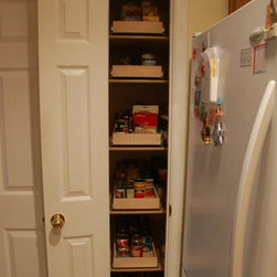 Pull Out Pantry Shelves - A narrow pantry made more accessible with slide out pantry shelves from ShelfGenie of Kentucky.