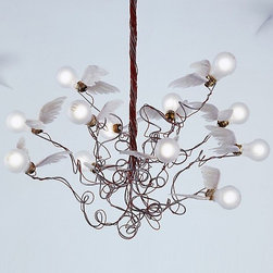 Birdie Chandelier by Ingo Maurer - This whimsical fixture brings big personality as well as light. From a distance it has an artistic sculptural silhouette, up close you notice the adorable wings on each bulb. This fits into a serious minimalist modern room as well as more eclectic transitional and collected spaces.