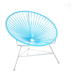 Innit Chair, Chrome Frame With Blue Weave - This iconic chair is perfect for outdoor living, as the woven vinyl is weather poof and easy to clean. But add it to a living room scheme and it brings the perfect pop of personality. You can order from a rainbow of colors to contrast the chrome base or stick with the classic black vinyl for a modern look.