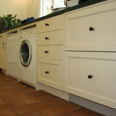 Mediterranean Laundry Room by Custom Spaces Design