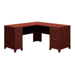 Bush Enterprise Commercial 60 Inch L-Shaped Desk - Harvest Cherry - Just because an office space is small doesn't mean it houses insignificant tasks - on the contrary, some days it seems the less room and time you have, the more important projects you have to complete. The Bush Enterprise Commercial 60 Inch L-Shaped Desk - Harvest Cherry offers dual solutions. On one hand, its small footprint and compact corner design will maximize office space, whether at home or in a small business. On the other, it doesn't skimp on desktop area - you can spread out on this spacious desk knowing you'll have plenty of room to dot every I and cross every T.This stylish L-shaped desk is crafted with strong laminate over durable, warp-resistant MDF. It's finished in a warm, modern Harvest Cherry shade complete with finished approach sides and slender metal pulls. One top drawer is perfect for stashing small supplies, while the cabinet below holds your CPU or other computer accessories. Two locking file drawers can accommodate and tidily enclose both letter- and legal-size files. All drawers glide on smooth, full-extension, ball-bearing slides for easy operation. A discreet, integrated 4-port USB hub makes hooking up computers, phone and PDA chargers, music players, printers, and other essential workday electronics easy, and a built-in wire management system helps keep cord clutter at bay.Minimal assembly is required, so you can get to work as soon as possible - or as soon as you finish that first cup of coffee. A 10-year manufacturer's warranty is included. Meets ANSI/BIFMA standards for safety and performance.About Bush FurnitureBush Furniture is the eighth largest furniture company in the United States. Bush manufactures high-quality products, which are designed to be easily assembled and provide great value for the price. Bush furniture is made from a combination of particleboard, fiberboard, and solid wood components. The use of real wood components will be noted in the product description, if applicable.Bush Industries has over 4,000,000 total square feet of manufacturing, warehousing, and distribution space. This allows for a very wide selection of high-quality furniture with the ability to ship quickly. All standard residential Bush products carry a generous 6-year warranty. All Bush business furniture, including the A series, C series, and Quantum series, is backed by a 10-year warranty from Bush, one of the best in the industry.Please note this product does not ship to Pennsylvania.