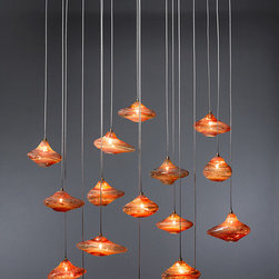Genie Chandelier - Soaring oil lamps populate the sky with a golden radiance.