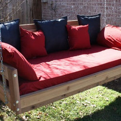 American Style Swinging Daybed - With the wide open spaces in its back and sides, the American Style Cedar Swinging Daybed is the perfect place to stretch out on a warm day and get some fresh air while swinging your cares away. The swinging daybed is sold in four sizes: a 75-inch by 38-inch Twin size, a 75-inch by 54-inch Full size, an 80-inch by 60-inch Queen size and an 80-inch by 76-inch King size. Your purchase includes a hanging chain set with hooks and mounting hardware, so all you'll need to complete your swing is a mattress. The swing is available finished or unfinished.