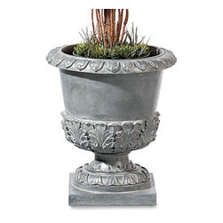 "Improvements - Leaf Urn - Each garden urn comes with two pot rings to keep a potted plant from shifting. These stylish garden urns can also be used for direct planting: simply fill with soil and add your own annuals or a small shrub. Use any of these stylish garden urns to add an elegant look to your entryway or patio or porch. Our Topiary Urns are the ideal way to show off one of our topiaries, or use them for direct planting. These stone-look garden urns are custom-sized to hold any of our life-like topiaries to create a look of classic elegance, outdoors or in. You can also add garden soil to the urns to grow live plants or small shrubs. Made of weather-resistant resin, the Topiary Urns can be left outside year round, plus they're suitable for indoor use, too! Each urn includes 2 interchangeable metal pot rings to hold a pot that's 7"", 8"" or 10"" in diameter. Choose from 5 styles. The Leaf Urn (greystone finish) is beautifully shaped with an acanthus leaf motif and pedestal base. Classic Swirl Urn (rustic brown) has a swirl design and pie crust rim to add a sophisticated look to your entryway. patio or porch. The Fluted Urn provides old-world elegance with a classic distressed fluted design on a square base. The urn is light green clay in color with slight hints of a darker green color for a moss effect. The Leaves and Berries Urn (black with rubbed red undertones) features a graceful embossed design and fluted detailing. Ivy Urn (Bordeaux red) features a vining design around the top and pedestal base.Benefits of the Topiary Urns:"